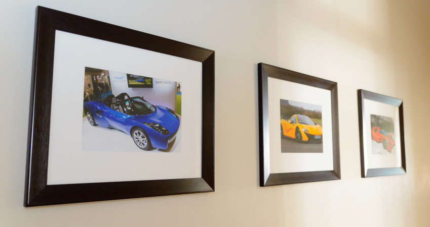 A number of Gordon Murray designed cars displayed in the corridor.